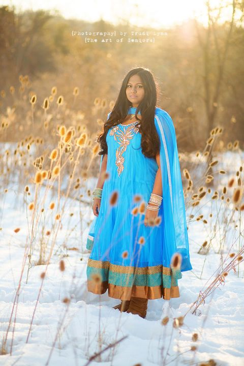 high school senior girl in a blue indian gown in the snow