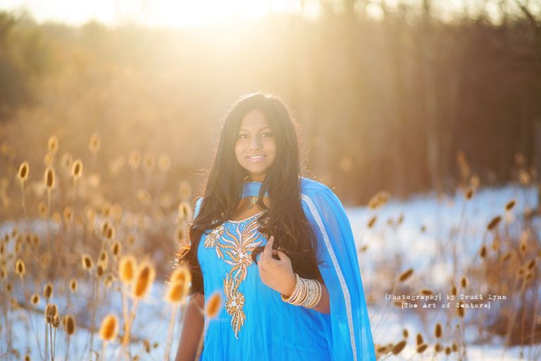 senior girl in the winter at sunset in the sunshine wearing an indian gown